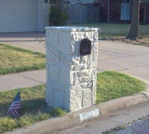Stone mailbox painted