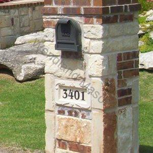 Stone mailbox with brick accents