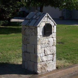 Stone mailbox with stone peak cap