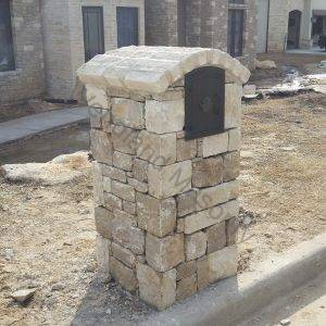 Dry stacked stone with brick crescent cap