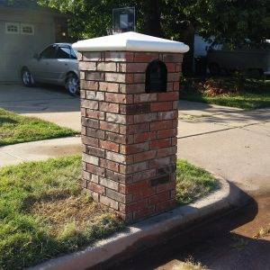 Brick with corbel and cast stone cap