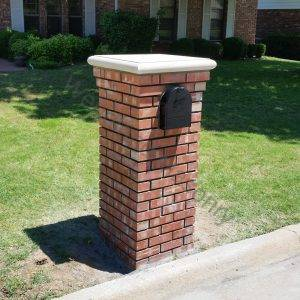 Brick with corbel and cast stone cap.