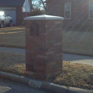 Brick mailbox with precast cap