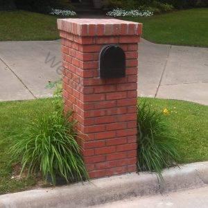 Brick with corbel and brick cap