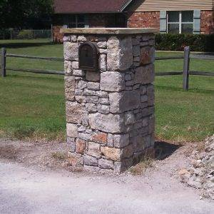Dry stacked stone with solid stone cap